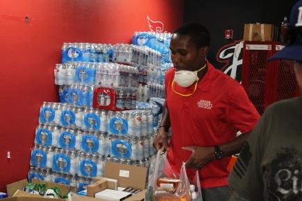 Caleb Unloading Donations